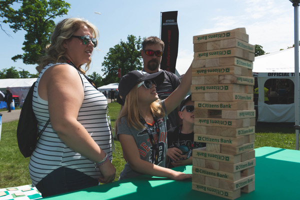 Fans enjoy playing Citizens Bank Giant Jenga in the Meijer Fan Zone during the Detroit Grand Prix