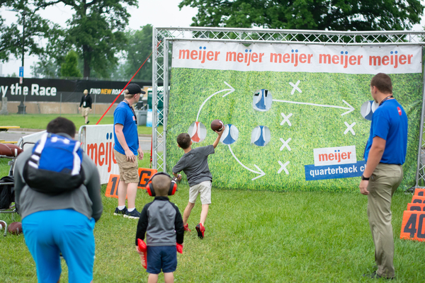 Fans starting the day at the Grand Prix by testing their quarterback skills in the Meijer Fan Zone
